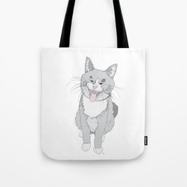 The cute grey cat is yawning Tote Bag