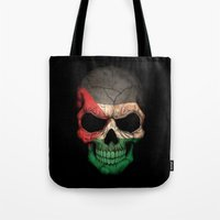 palestine Tote Bags featuring Dark Skull with Flag of Palestine by Jeff Bartels