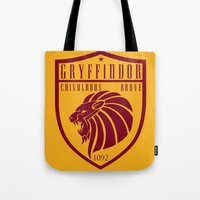 gryffindor Tote Bags featuring Gryffindor Crest by machmigo