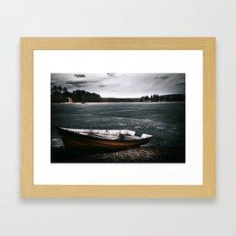Boat on frozen shore Framed Art Print