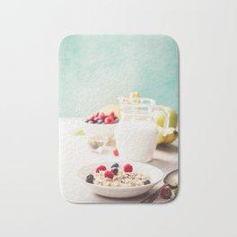 Oatmeal porridge with fresh berries, fruits and almond milk. Bath Mat