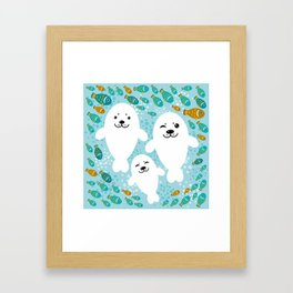 happy family of white seals and fish on a blue background. Framed Art Print