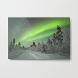 Aurora borealis over a track through winter landscape, Finnish Lapland Metal Print