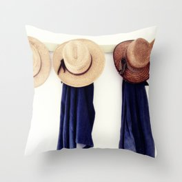 Men's straw hats, hanging inside the farmhouse at Yoder's Amish Home Throw Pillow