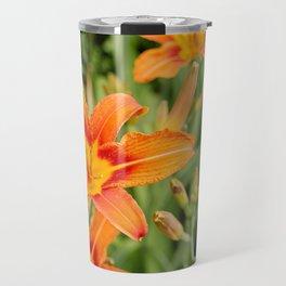 Orange flowers in the green Travel Mug