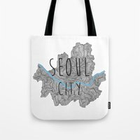 seoul Tote Bags featuring Seoul city by Vania Pietronigro