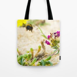the flight of bumble bee on the bunes Tote Bag