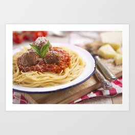 Spaghetti with meatballs and parmesan cheese on a rustic table Art Print