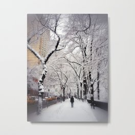 A man walks under snow covered trees along New York's 5th Avenue beside Central Park Metal Print