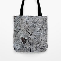 tree rings Tote Bags featuring Rings by Elizabeth Velasquez