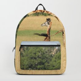 GIRAFFE WITH YOUNG GRAZING ON THE FIELD Backpack