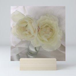 hopeful: two winter roses Mini Art Print