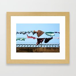 Hanging laundry in blowing wind Framed Art Print