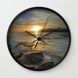 Crepuscular rays at the sea Wall Clock