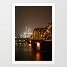 Hohenzollerrn brige and dom in Cologne with river Rhine at night. Germany Art Print