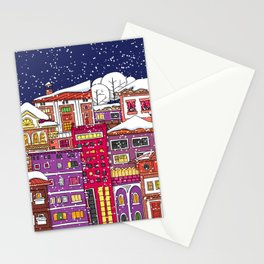 Winter town with falling snow. Stationery Cards