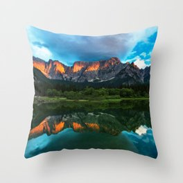 Burning sunset over the mountains at lake Fusine, Italy Throw Pillow