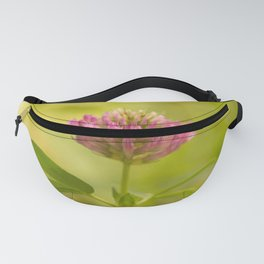 Red clover on green blur nature background #decor #society6 Fanny Pack