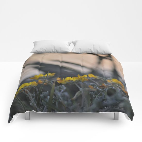 """Yellow flowers looking at sea sunset"" Comforters"