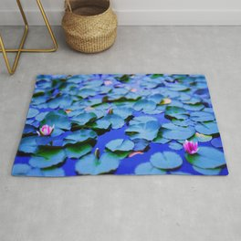 Water lilies in a pond Rug