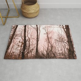 Foggy morning in the forest Rug