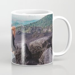 Young brunette woman lets down with long hair at the end of a hike on Pacaya Volcano, Guatemala Coffee Mug