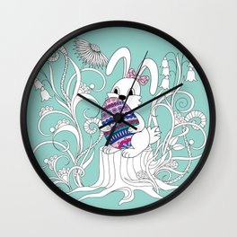 Cute easter rabbit with ornamental egg into flowers Wall Clock