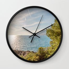 Sunlight reflected on the sea of Cap Martin in a sunny winter day Wall Clock