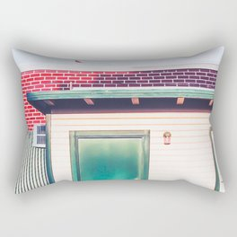green wood building with brick building in the city Rectangular Pillow