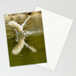 The heron lays on the placid river... Stationery Cards