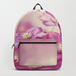 Purple clematis flowers for background Backpack