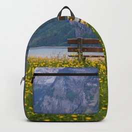 Switzerland Photography - Bench Sitting In The Middle Of A Yellow Flower Field Backpack