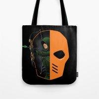 superheros Tote Bags featuring Masked by Dooomcat