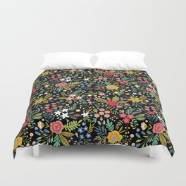 Amazing floral pattern with bright colorful flowers, plants, branches and berries on a black backgro Duvet Cover