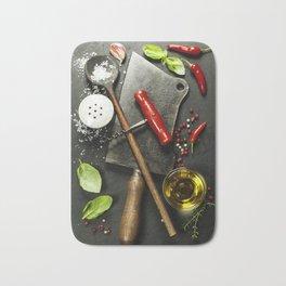 Vintage cutlery and fresh ingredients on dark background Bath Mat