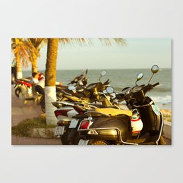 Scooters parked on parking with sea bay on the city beach Canvas Print