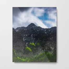 Sun lit green forest beneath the mountains Metal Print