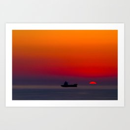 Silhouette of a ship on the ocean at red sunset with half sun ball at the horizon Art Print