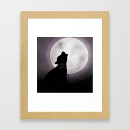 Howling at the moon Framed Art Print