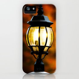 Lamp Post Against Fall Trees iPhone Case
