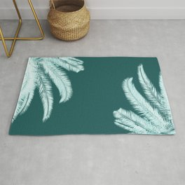 Palm leaves silhouettes on teal Rug