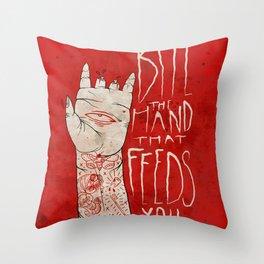 bite the hand. Throw Pillow