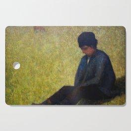 Boy Sitting in a Meadow Cutting Board