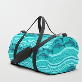 A flock of dolphins in the sea, strips and borders. Marine seamless pattern. Duffle Bag