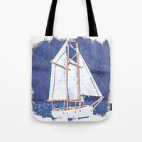 sailboat Tote Bags featuring Sailboat by Michael P. Moriarty