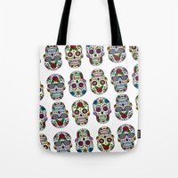 sugar skulls Tote Bags featuring Sugar skulls by very giorgious