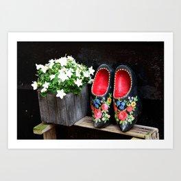 Clogs and te flowers Art Print