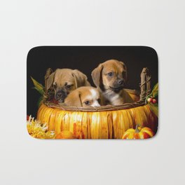 Pumpkin Basket Filled with Two Puggle Puppies and a Beaglier Puppy for Halloween Bath Mat