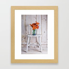 Daylillies on a white chair Framed Art Print