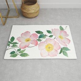 pink rosa rubiginosa watercolor Rug